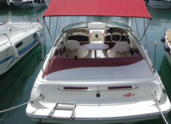 Rent a motorboat Rinker 212 in Marina de Dénia, Denia