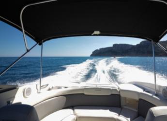 Rent a motorboat Rinker 246 in Marina de Dénia, Denia
