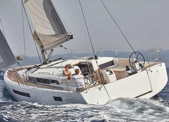Rent a sailboat in Marina Mandraki - Sun Odyssey 490 (GEN+A/C+WM)