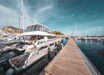 Rent a power catamaran  in Marina di Cannigione - Lagoon 630 MY (5cab)