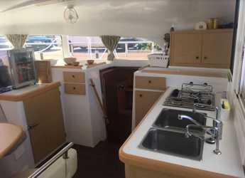 Rent a catamaran Lagoon 380 in Puerto deportivo Marina La Bajadilla, Marbella