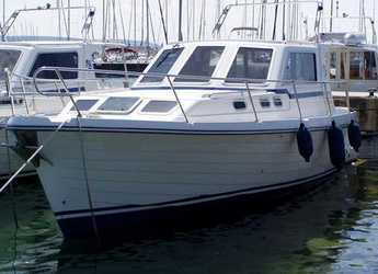 Rent a motorboat in Trget Port - Adria 1002